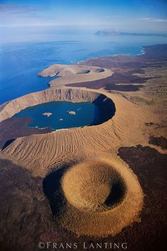 Aerial view of volcanic craters, Isabela Island, Galapagos Islands, Ecuador. The largest of the Galapagos Islands, Isabela is one of the most volcanically active places in the world. © Frans Lanting (V) Photo Volcan, Places To Travel, Places To See, Places Around The World, Around The Worlds, Equador Quito, Frans Lanting, Photos Voyages, Galapagos Islands