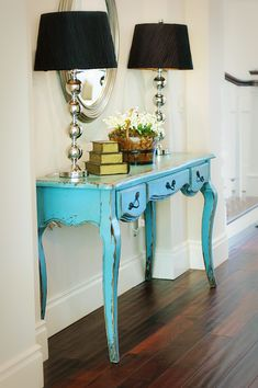 Distressed teal table with more modern looking lamps. Great use of entryway space. Similar lamp can be found here: http://www.myknobs.com/litls21157.html