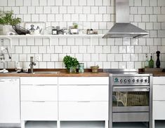 Square tile, probably 6x6, in a brick pattern with dark grout. Love the way it looks with the wood {?} countertops and white cabinets.