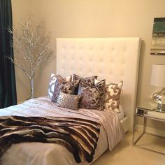 Allison styles her guest room with contemporary class using Z Gallerie Pillows, Encore Side Table, Sabrina Table Lamp, Silver Twig Potted Tree and Zambia Throw.