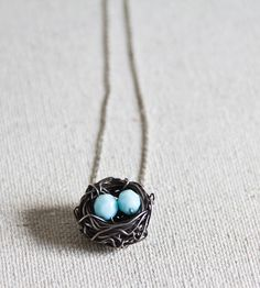 Bird's Nest Silver Necklace | Two bright blue beads adorned this lovely wire nest necklace. ... | Necklaces