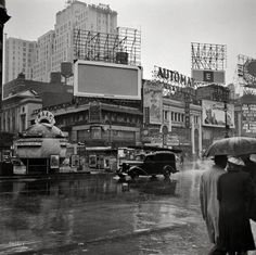 """March 1943. """"New York, N.Y. Times Square on a rainy day."""""""