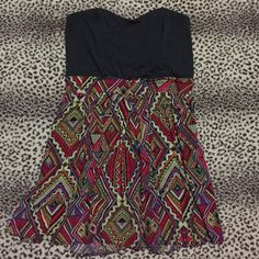 Aztec print mini strapless dress Worn once....mini strapless, pull on (no fuss with zippers or buttons perfect for summer) black bodice, and print skirt. Falls at mid thigh. Size large Xhilaration Dresses Mini