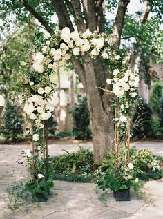 Organic neutral color palette wedding arch: http://www.stylemepretty.com/2016/12/31/biggest-wedding-trends-2017/