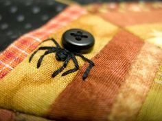 Spooky Halloween Embroidery D.I.Y Pattern Inspiration * A Black Button & A Few Hand Embroidery Stitches = A SCARY SPIDER for Halloween! * To make a Black Widow Spider, sew on the button with red embroidery floss.