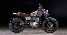A Suzuki VanVan with a surfer vibe, a track-ready Ducati Monster from the Emirates, and a sneaky peek at Moto Guzzi's cool new TT—an ADV bike with a 'classic … Yamaha Cafe Racer, Cafe Racer Motorcycle, Moto Bike, Cafe Racers, Old School Motorcycles, Custom Motorcycles, Custom Bikes, Chopper, Scooters