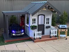 An Australian father has gone above and beyond to build his toddler son the ultimate cubby house - complete with a carport, a Mercedes convertible and an outdoor barbecue. Boys Playhouse, Backyard Playhouse, Backyard Playground, Kids Outside Playhouse, Little Tikes Playhouse, Playhouse Decor, Playhouse Interior, Kids Cubby Houses, Kids Cubbies