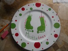 Every Christmas I make a charger plate (big plate from Micheals) This year I took their foot prints and made a Mistle...toes plate. Loads of fun for me and the kids really love getting their feet painted. Parents love the keepsake.