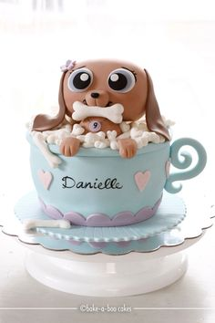 Adorable Littlest Pet Shop Cake.  My sister would love a puppy in a teacup cake.. even though her next birthday she will be 25... hehe