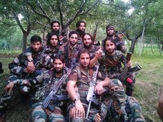 On-the-run PSO poses with fellow militants