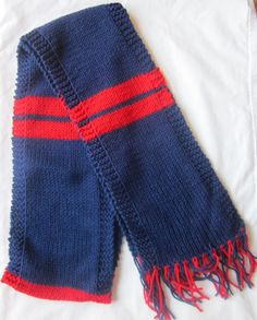 Show your spirit with a knit scarf in Houston Texans colors! Keep warm during those cold football games.    Scarf measures 60 inches long