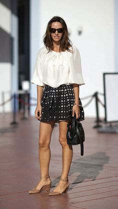 A simple printed skirt adds pattern to a silk blouse. www.justblynk.com