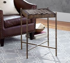 Brass & Leather Game Table-This little table is truly multi purpose. It's a handsome accent, a chess/checkers table and there is backgammon hidden inside.  It features a leather top and antique brass legs from @potterybarn