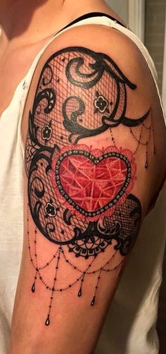 Lace tattoo with diamond heart