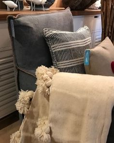Pom poms galore at the moment 💕💕 wool and cotton throw on our loose cover armchair and some cute cushions too 😍 #beachwood #linen #wool #cotton #chair #furniture #shop #avalon #nofilter