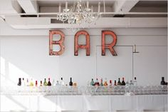 simple bar area in a white room with BAR sign