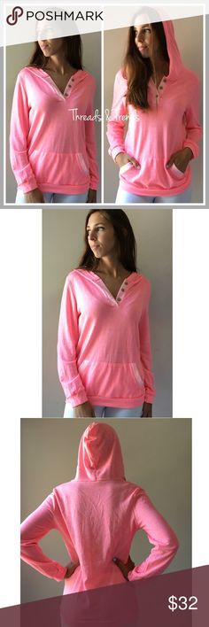 Two Toned Coral Hoodie Two toned coral hoodie with three button detailing. Hooded with a front pocket. Made of a cotton blend Tops Sweatshirts & Hoodies