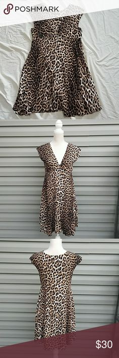 """Zara Woman Leopard Print Dress Leopard print V neck babydoll style mini dress made of 100% viscose. Has a 90s vibe. Would be great as is or layered over a cami. Laid flat armpit to armpit is 17.75"""" and empire waist is 16.75"""". Flares out more at natural waist. It's a pull on style, so no messing with zippers. Length from  bottom of the empire waist to hem is 24"""", making it almost knee length. This dress would be great with a strappy bralettes. Would be excellent for travel because it doesn't…"""