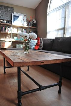 "Wood Coffee table with steel pipe legs made of reclaimed wood, 18"" tall x 48"" L x 20"" w"
