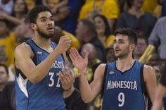 Minnesota Timberwolves center Karl-Anthony Towns (32) is congratulated by guard Ricky Rubio (9) after making a basket while being fouled against the Golden State Warriors during overtime at Oracle Arena. The Timberwolves defeated the Warriors 124-117.  #9233348