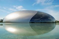 "Egg Building (China) ~ This beautiful structure known as ""The Egg"" is China's National Centre for the Performing Arts. This dome-shaped building is submerged in water and contains an Opera House, a Concert Hall, and a Theater. Remarkably, this building is just as massive and intriguing below the surface of the water. ""The Egg"" is home to underwater corridors, an underwater garage, and even an artificial lake. The structure took over five years to build."