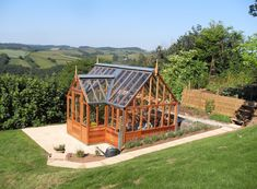 The Portico RHS Greenhouse - The portico comes with a central porch allowing access to the greenhouse from the side and can have coldframes added either side of the porch - Gabriel Ash Greenhouse Frame, Porch Greenhouse, Diy Greenhouse Plans, Best Greenhouse, Greenhouse Gardening, Outdoor Buildings, Garden Buildings, Cheap Raised Garden Beds, Raised Beds
