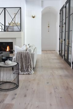 3 simple ways to welcome fall into your contemporary living room. Luxe faux fur, earthy color tones and statement vases to fill with fall folliage. Living Room Flooring, Living Room Furniture, Living Room Decor, Condo Living, Home And Living, Living Room With Fireplace, Other Rooms, Fashion Room, Decorating Your Home