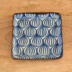Blue-and-White plates by Japanese potter Watanabe Ai. She gets inspiration from everyday objects