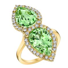 "Magnificent ""Twin"" Peridot and Diamond Ring by Tamir. Rare, ""neon blue"", 15.62 carat, oval, cabochon, Paraiba Tourmaline, surrounded by 1.64 carats of Rose Cut diamonds and accented by 1.56 carats of Single Cut diamonds on the spheres."