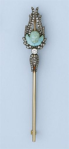 AN ANTIQUE TURQUOISE AND DIAMOND PIN, BY KOCH -  Composed of a carved turquoise cherub to a rose-cut diamond set winged background, circa 1890