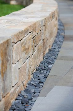 What I like: love this French drain and retaining wall idea for the backyard. Also keeps with the tan and gray color scheme. Landscape Walls, Landscape Design, Garden Design, Stone Retaining Wall, Retaining Walls, Patio Stone, Brick Pavers, Modern Patio Design, Stone Wall Design