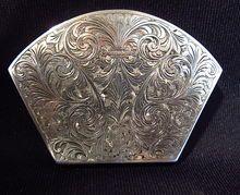Silver Compact.....