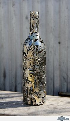 Key Bottle Metal Sculpture(this is a good idea to keep all the useless keys u have ever had and put them in a pretty wine bottle)☺