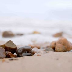 Pebbles on a beach by Claireberries Photography
