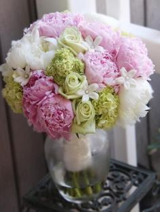 Pink and white peonies with stephanotis, mini green hydrangea and green roses