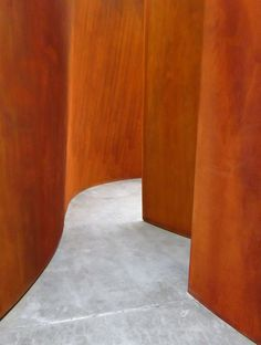 """Interior of """"Connector"""" a 65-feet-high, 360-ton sculpture of weathered steel by Richard Serra."""