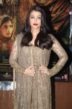 Aishwarya Rai Bachchan looks absolutely amazing in a dull gold Sabyasachi suit