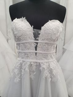 This beautiful straless deb gown has a lace covered bodice with a see-thorugh panel at the bust and under the arms . The three layer belt helps highlight a slim waist and bring out your hourglass figure. Hourglass Figure Dress, Deb Dresses, Slim Waist, Bodice, Tulle, Size 10, Satin, Gowns, Wedding Dresses
