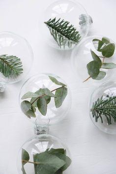 DIY greenery glass ornaments.
