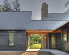 Hardi Wood Siding to Makes an Excellent Exterior : Use Of Hardi Wood Board Siding A Stone Base And A Standing Seam Metal Roof Make This A Low Maintenance Home