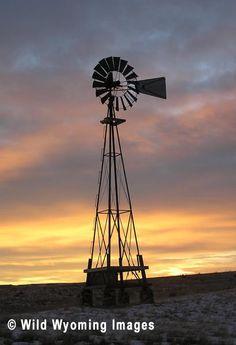 Windmill at Sunrise - Windmill photograph and sunrise at Mountain Plains Heritage Park, Buffalo, Wyoming.