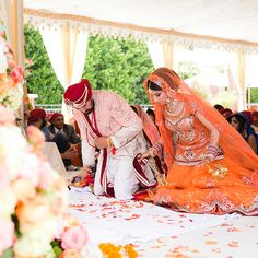 The couple take part in a traditional Sikh ceremony