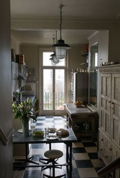 Antique looking closet as kitchen cupboard + modern stools: FleaingFrance Brocante Society Great small kitchen