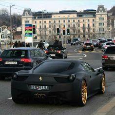 Diggin' on the flat black and gold Ferrari
