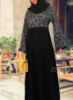Be chic in the Rayah abaya dress. One of our most popular designs. Printed gray viscose fabric with black leaf design on top and arms. Black from waist down to give slimming effect. Abaya Fashion, Muslim Fashion, Modest Fashion, Fashion Dresses, Islamic Fashion, Modest Dresses, Modest Outfits, Iranian Women Fashion, Maxi Outfits