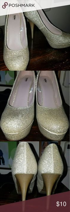 Gold sparkly heels I'm selling my size 8.5 high heels gently used. They're beautiful! Prices are always negotiable! Mossimo Supply Co Shoes Heels