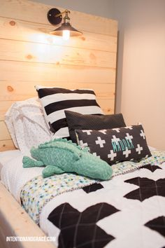 Custom Toddler boy twin lighted bed featuring geometric plus sign quilt and room tour  |  intentionandgrace.com