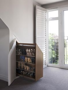 This is a must!    Great use of space under stairs to store shoes