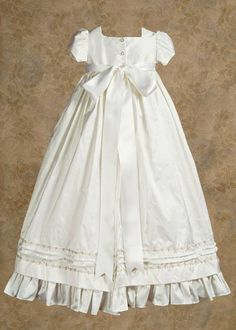Classic long silk blessing or christening dress with gorgeous bow in the back.