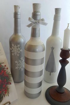 Add a little Christmas flair to your mantle this season with a set of three hand-painted wine bottles in silver and white with white cork accents. These would also serve as a great addition to a dramatic tablescape for the Holiday. . . . And if you can resist getting these for yourself,